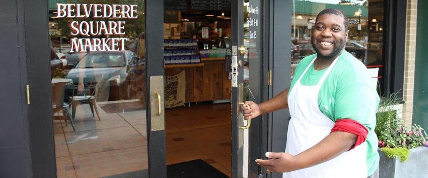 man opening te door of his place of employment