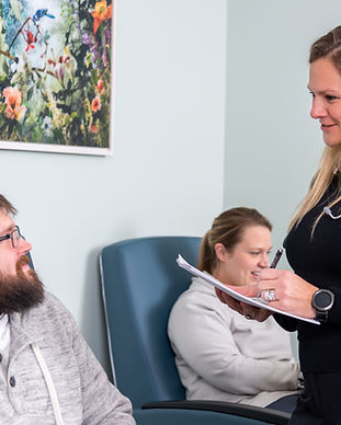 Nurse practitioner helping patient