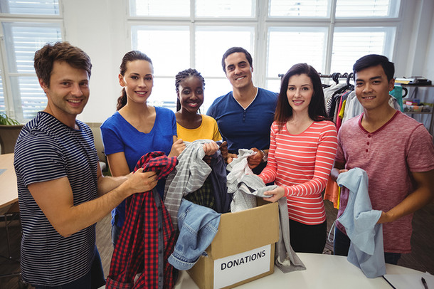 group-volunteers-checking-clothesresized