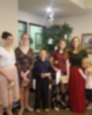 First String Violinist poses with violin sudents at Christmas recital
