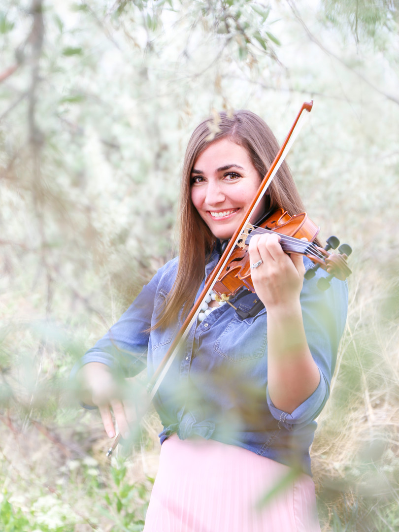 Utah event musician Jessica McAllister plays the violin in the trees.