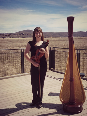 Jessica McAllister, First String Violinist plays the violin for a wedding with a harp in Park City, Utah.