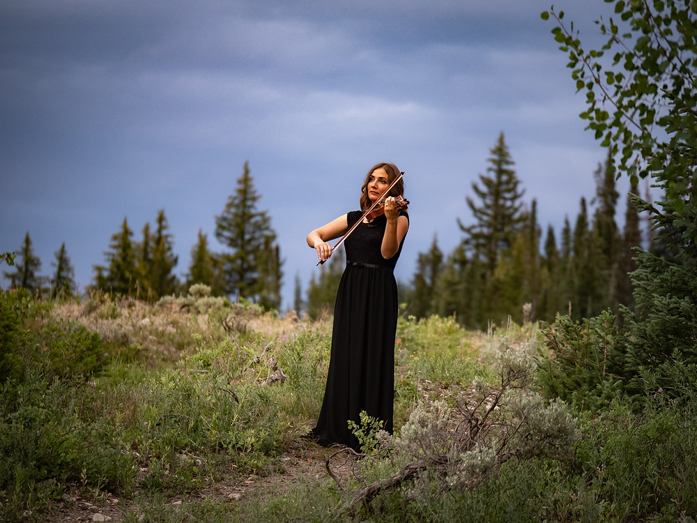 Jessica McAllister performs violin in Utah mountains