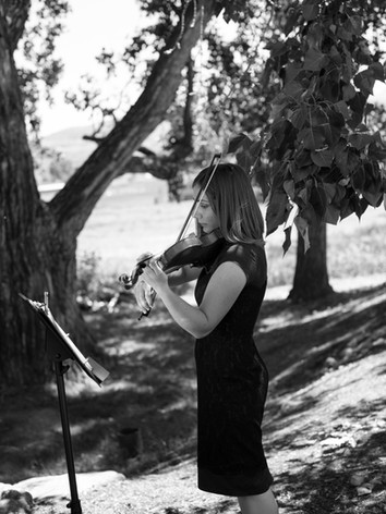 Jessica McAllister performs the violin for an outdoor wedding in Utah.