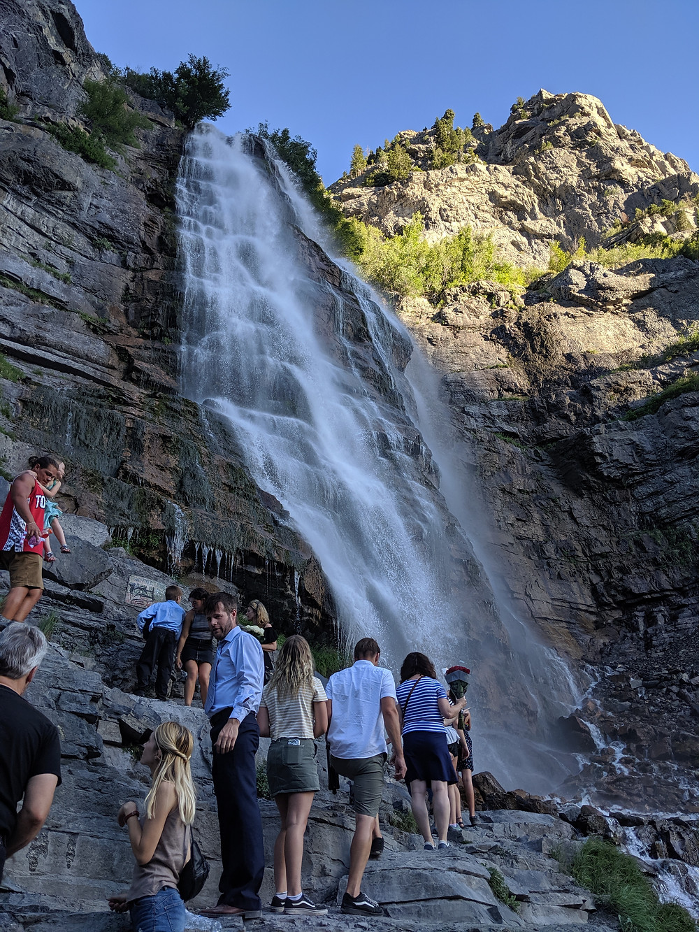 violinist Jessica McAllister plays at an event at bridal veil falls in provo UT