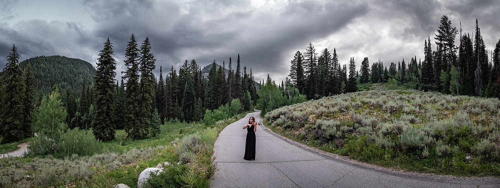 panoramic view of Jessica McAllister playing violin in Utah mountains