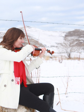 Violinist Jessica McAllister plays beautiful music in the snowy Utah mountains.
