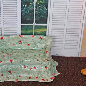 Hand built porcelain sofa with floral decoration.