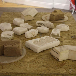 Bricks and linen embroidery sprig moulds.