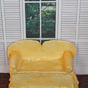 Hand built porcelain sofa with honey glaze.