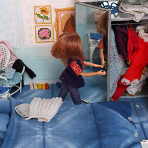 Sindy bedroom with indigo dyed bedding and treasured hand made clothes.