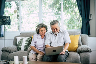 senior-couple-talking-with-laptop-comput