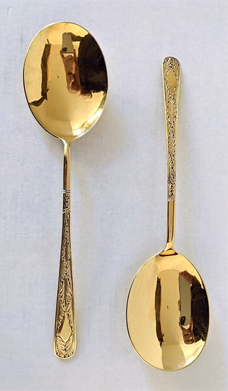 A PAIR OF GEORGE III SILVER GILT SERVING SPOONS LONDON 1810 & 1811