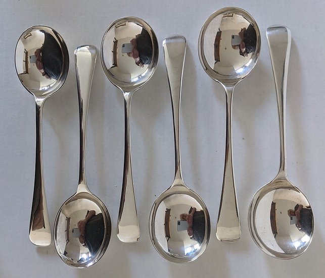 A set of 6 solid silver soup spoons 386 grams Sheffield 1922