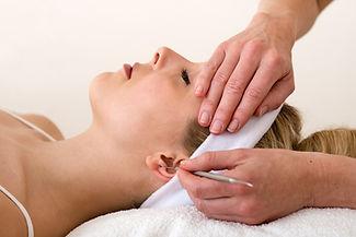 Chiropractor applying ear acupuncture te