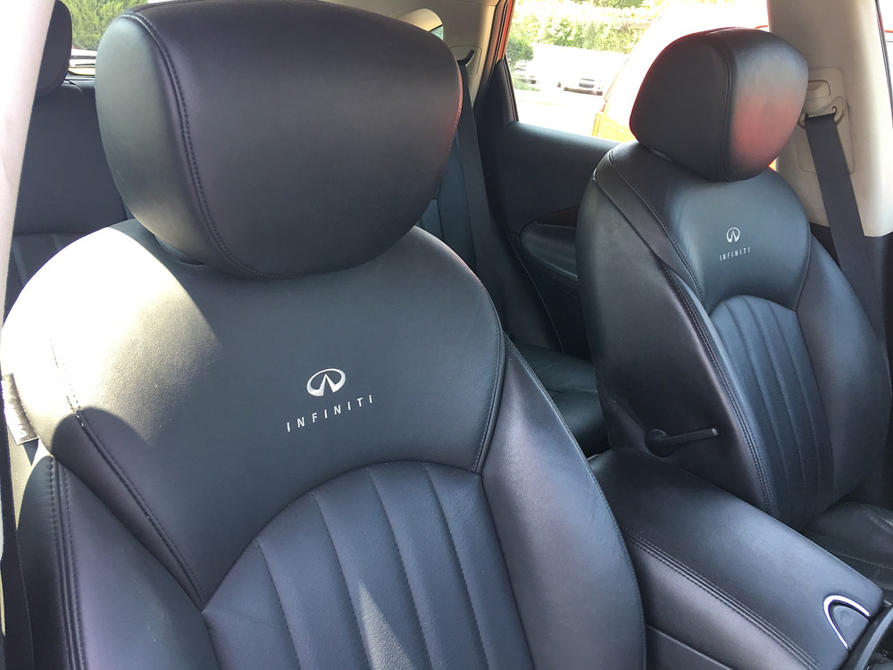 Infiniti Logo Detailing in the Leather Seats