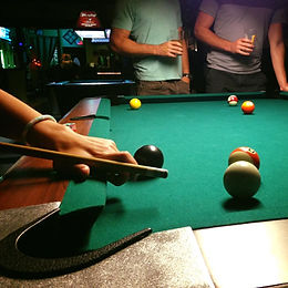 Locals playing a game of pool at Wooly's Celtic Pub in Johnstown, PA