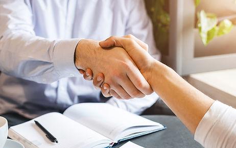 handshake-of-two-businessmen-during-lunc