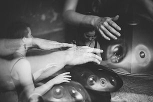 hands playing handpan