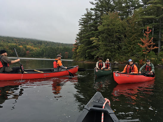 UMF students and faculty canoeing for a field work experience.