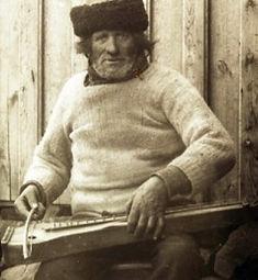 Jón Ásbjörnsson playing langspil 1897