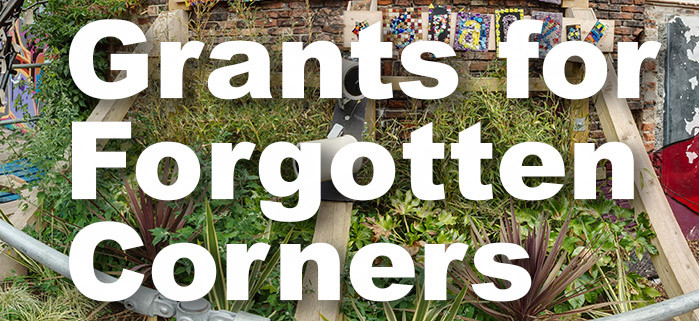 """A photo of a green area with text overlayed saying """"Grants for Forgotten Corners"""""""