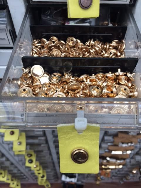 Gold purse snaps that were one of many options to select for purse design details