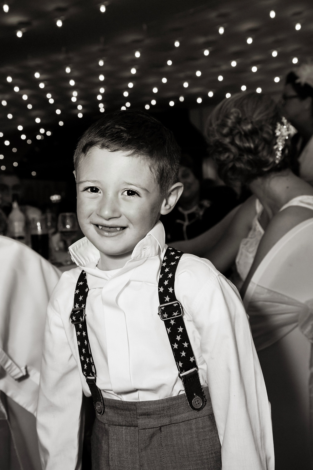 Wedding photograph of child posing for the camera