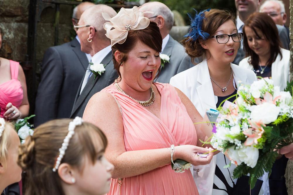 Wedding guests at Llanharan church Rhondda Cynon Taf