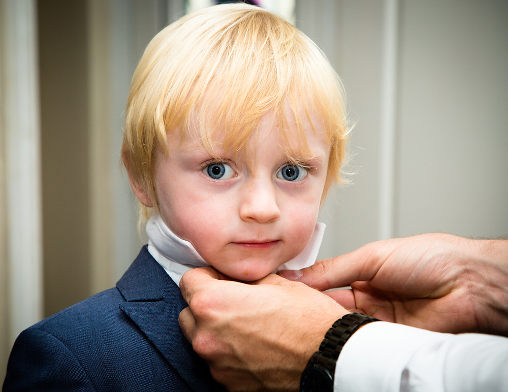 Child getting ready to attend a wedding in Maes Manor Blackwood