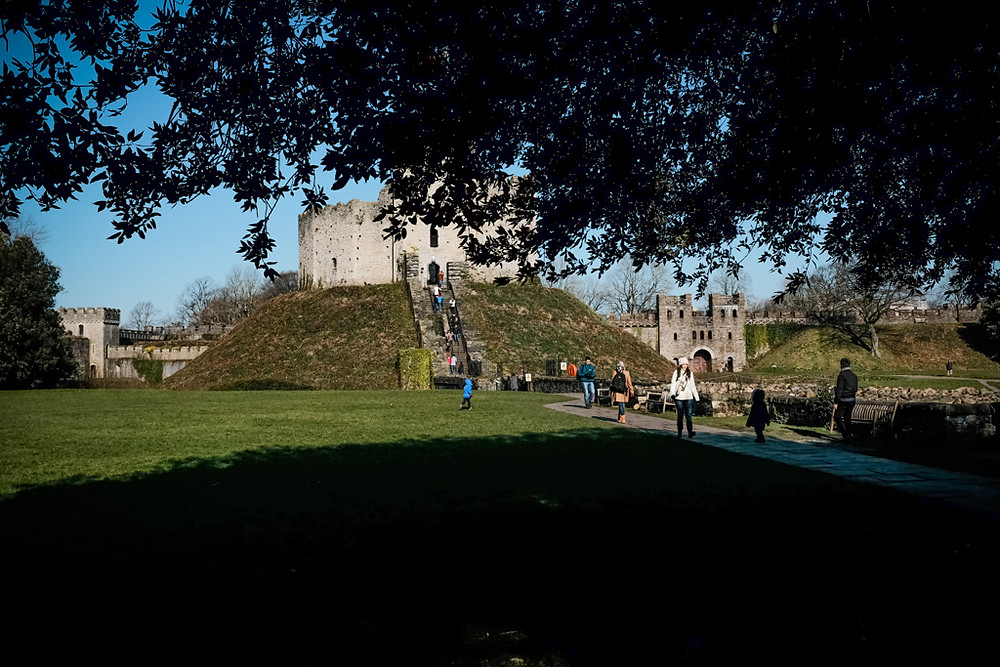 Tourists walking to the keep at Cardiff castle