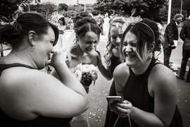 Bride having a moment with her maids