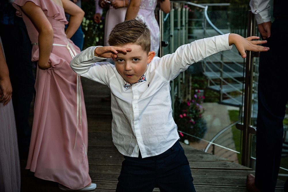 Child at a wedding joining in the wedding fun
