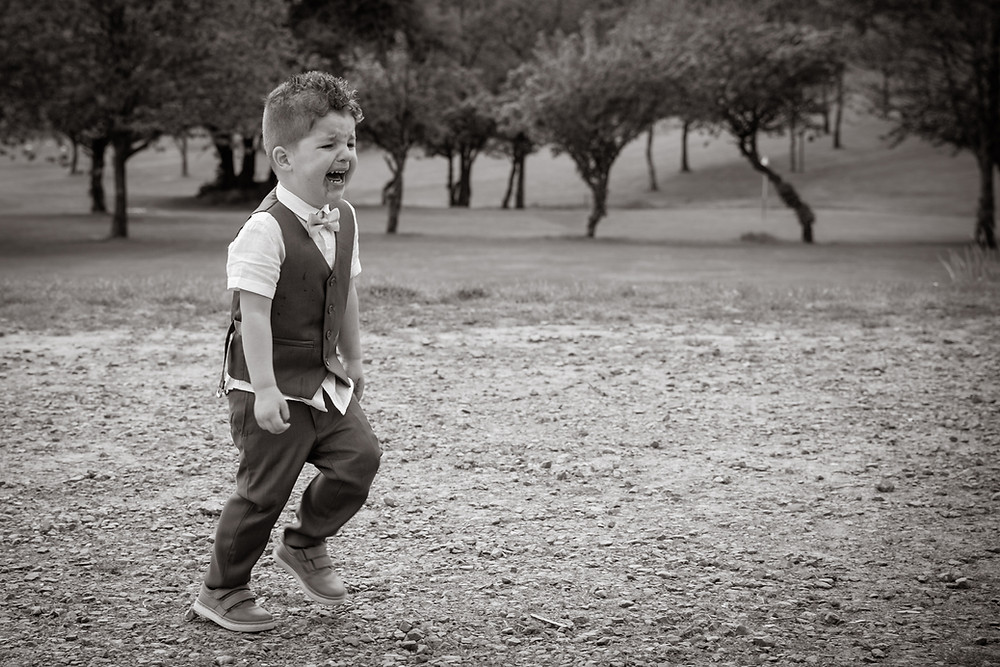 Child crying for some more sweets at a wedding