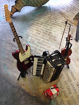 Electric guitar, accordion, violin