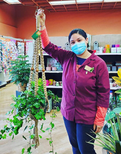 Woman Holding Up Her New Macrame Plant Hanger