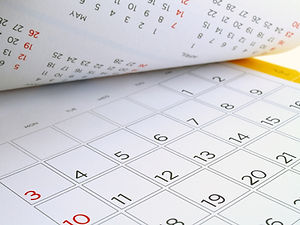 desk calendar with days and dates in Jul