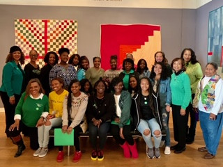 Mentees at quilting exhibit