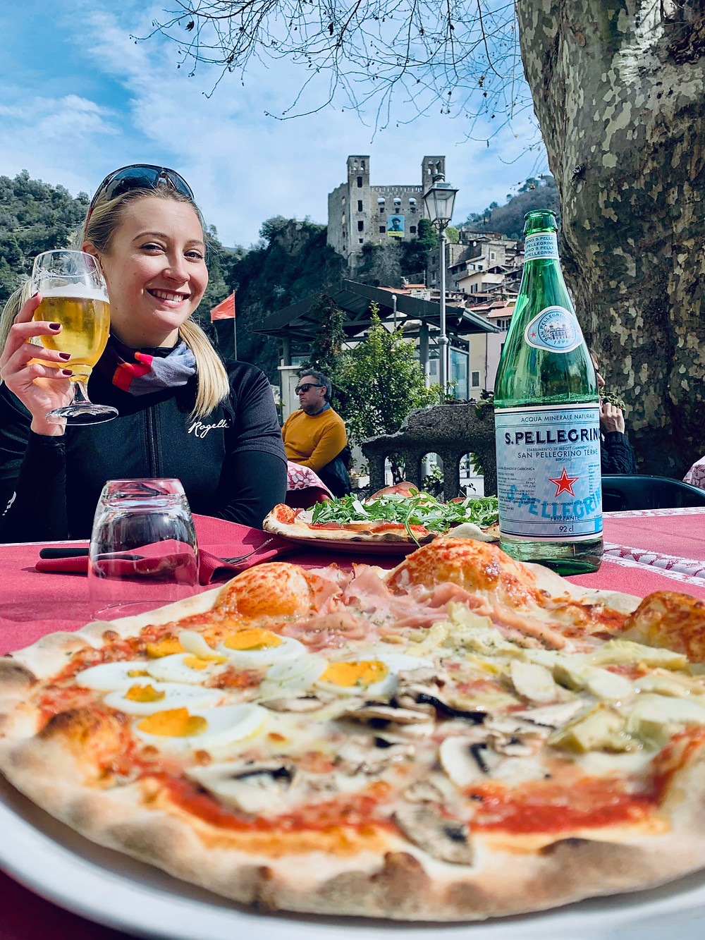 Pizza, female cyclist, beer, panorama