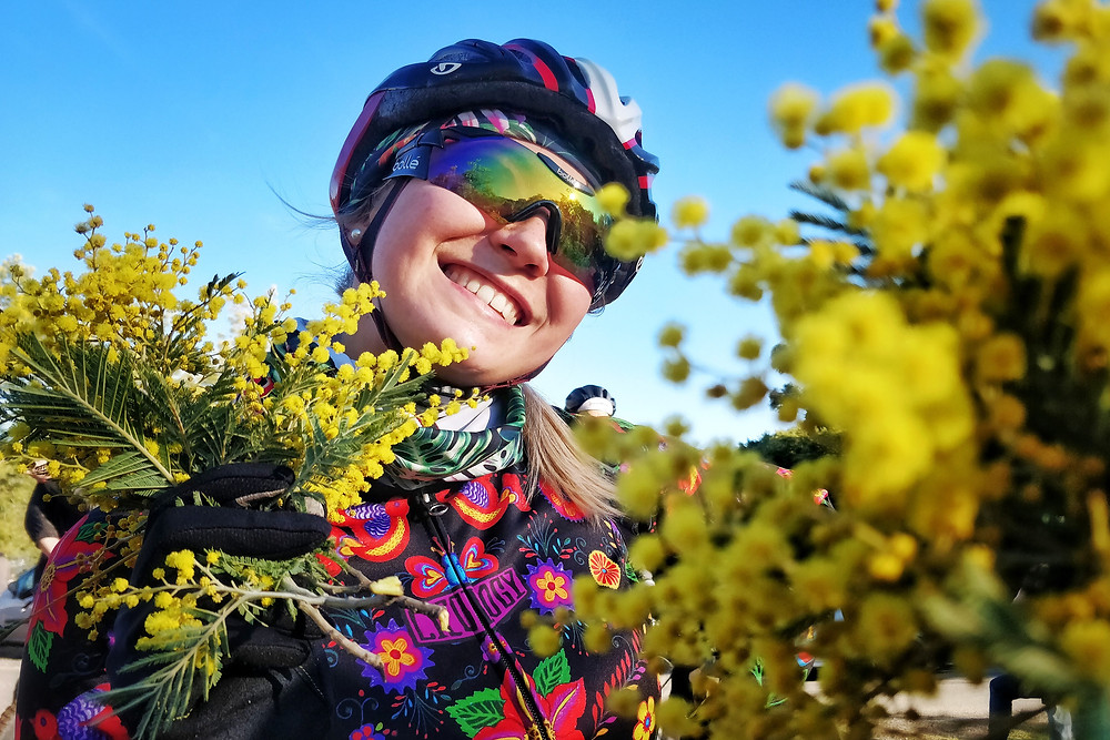 She's a Cyclist female cyclist with mimosa