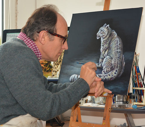 Artist Karl snow leopard painting on leather