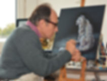 Artist Karl Hamilton-Cox painting snow leopard on leather Hereford UK known as leatherman