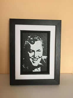 Bill Haley monochrome portrait painted on leather by the leather artist Karl Hamilton-Cox