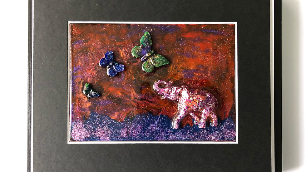 Pink elephant and butterflies