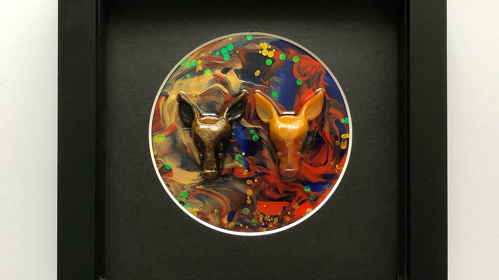 Brown gold red blue mounted animal heads