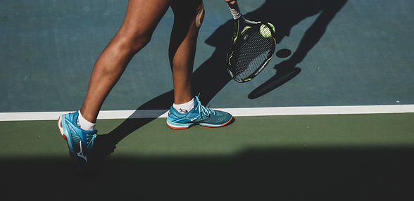 woman%20holding%20tennis%20ball%20and%20