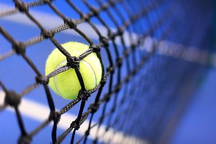 tennis ball on a tennis court.jpg