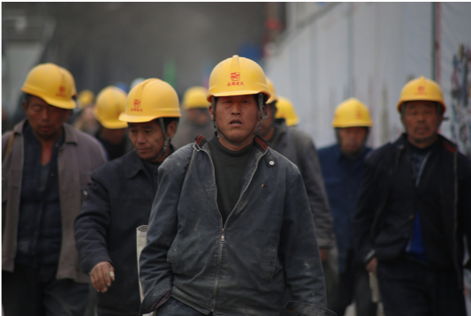 a group of mine workers walking together