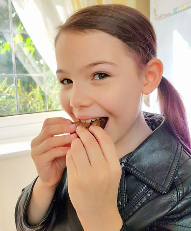 Pretty girl eating a brownie and chocolate cake