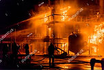stock-photo-firemen-using-water-from-hos